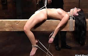 Sexy petite brown in hogtie caned