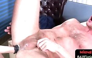 Horny bdsm stud jiggles his fist inside ass