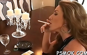 Lovable babe sucks a dick like a tart greatest extent smokin'_ a cig
