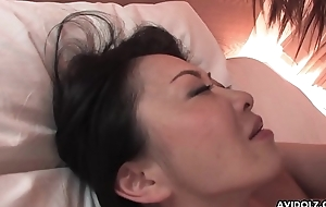 Hairy Japanese chick with big tits pussy fucked missionary style
